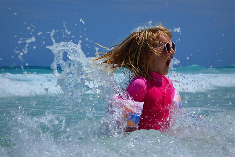 children-swimming-water-sea