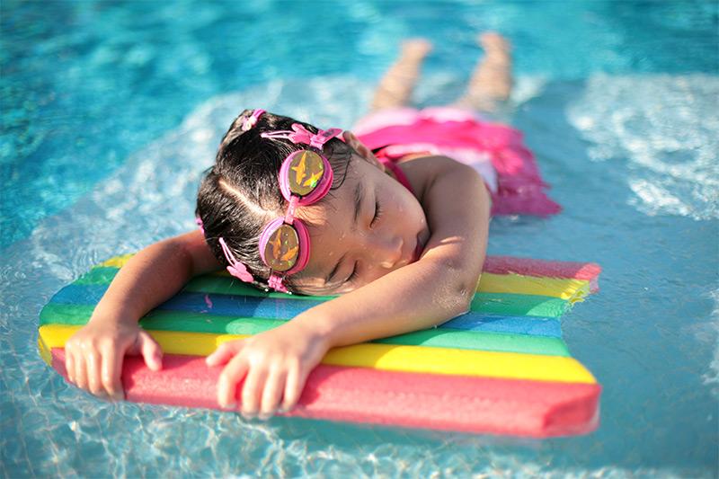children-swimming-water