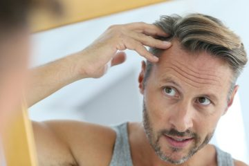 middle-aged-man-concerned-by-hair-loss-grey-hair-irritated-goodluzs